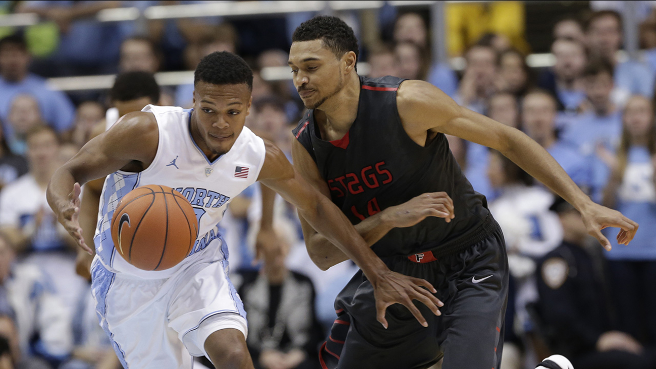 North Carolina's Nate Britt, left, and Fairfield's Marcus Gilbert chase the ball during the first half of an NCAA college basketball game in Chapel Hill, N.C., Sunday, Nov. 15
