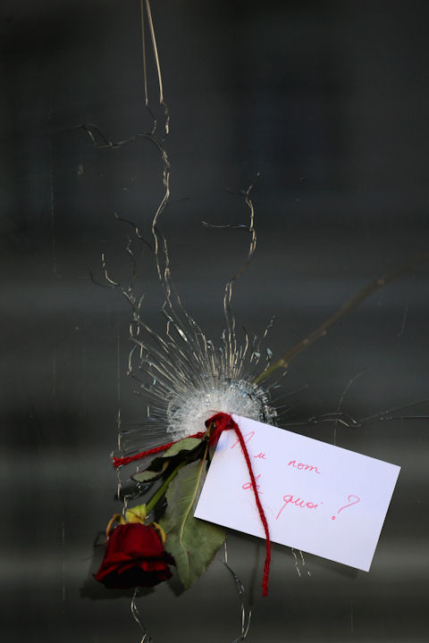 <div class='meta'><div class='origin-logo' data-origin='none'></div><span class='caption-text' data-credit='Christopher Furlong/Getty Images'>A rose is placed inside a bullet hole in the window of the  La Belle Equipe restaurant where the Paris terror attacks took place. An attached note reads,''In the name of what?''</span></div>