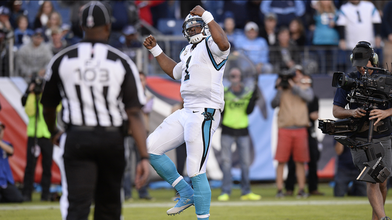 Carolina Panthers quarterback Cam Newton dances after scoring a touchdown against the Tennessee Titans in the second half of an NFL football game Sunday, Nov. 15, 2015