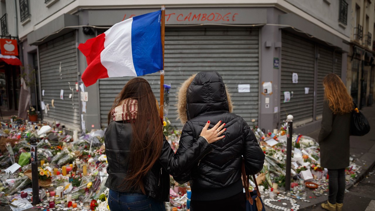 Two women stand outside the Petit Cambodge restaurant, a site of last Friday's attacks, in Paris, Tuesday, Nov. 17, 2015.