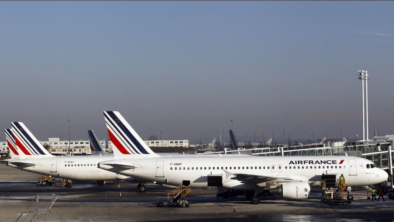 Air France planes are parked on the tarmac at Paris Charles de Gaulle airport, in Roissy, near Paris, Tuesday, Feb. 7, 2012.