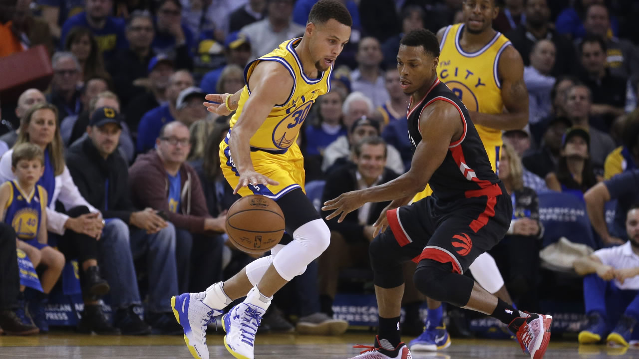 Golden State Warriors' Stephen Curry, left, drives the ball against Toronto Raptors during the first half of an NBA basketball game Tuesday, Nov. 17, 2015, in Oakland, Calif.