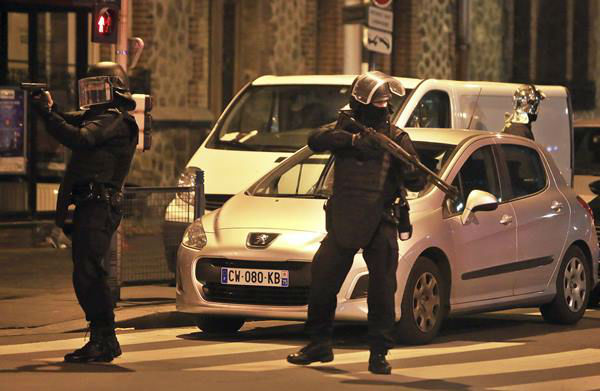 "<div class=""meta image-caption""><div class=""origin-logo origin-image none""><span>none</span></div><span class=""caption-text"">Police officers take up positions in Saint Denis, a northern suburb of Paris, Wednesday, Nov. 18, 2015. (AP Photo/Thibault Camus)</span></div>"