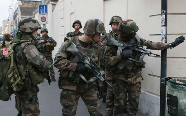 "<div class=""meta image-caption""><div class=""origin-logo origin-image none""><span>none</span></div><span class=""caption-text"">Soldiers operate in Saint-Denis, a northern suburb of Paris, Wednesday, Nov. 18, 2015. (AP Photo/Francois Mori)</span></div>"