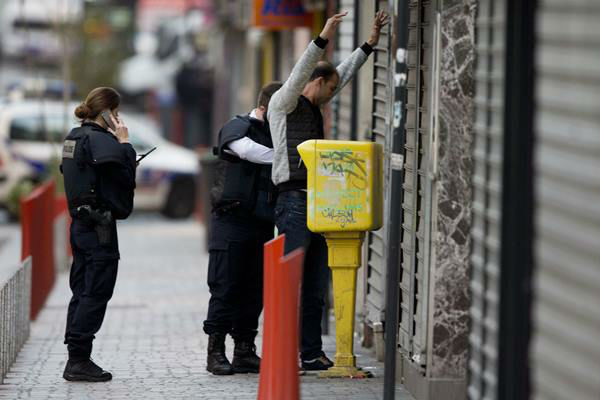 "<div class=""meta image-caption""><div class=""origin-logo origin-image none""><span>none</span></div><span class=""caption-text"">A resident is being searched by police officers in Paris suburb Saint-Denis, Wednesday, Nov. 18, 2015. (AP Photo/Peter Dejong)</span></div>"