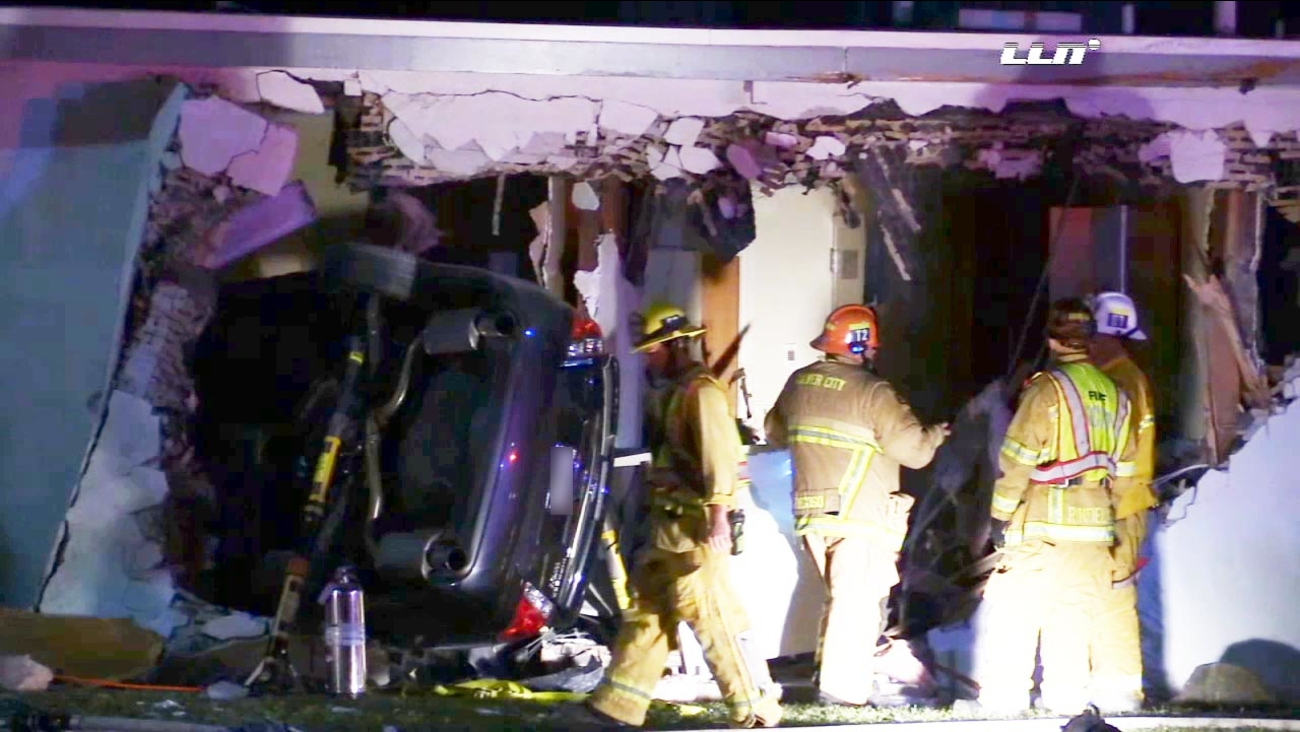 Police said a suspected drunk driver lost control of the car, jumped a curb and crashed into a church in Culver City during a street race with another car Wednesday, Nov. 18, 2015.