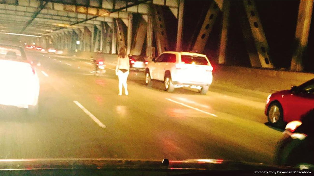 A driver snapped a photo of a scantily clad woman walking in the center lane of the eastern spand of the Bay Bridge, Nov. 18, 2015.