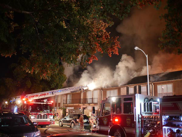 <div class='meta'><div class='origin-logo' data-origin='none'></div><span class='caption-text' data-credit='iWitness Photo / John Harris'>At least one person was taken to the hospital in a fire that broke out at a townhome complex in west Houston.</span></div>