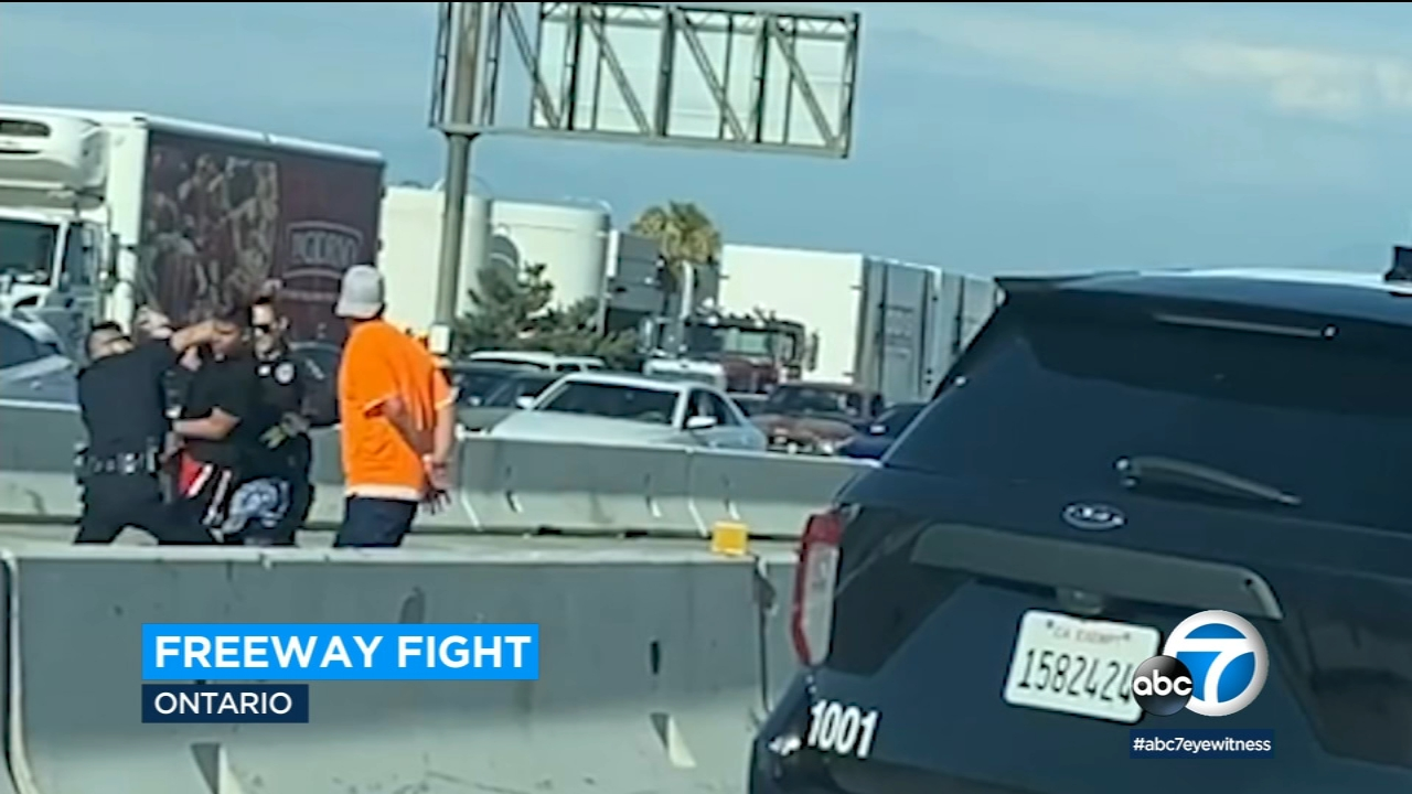 Video: Fight breaks out on 60 Freeway in Ontario after crash, officer tackles men to ground