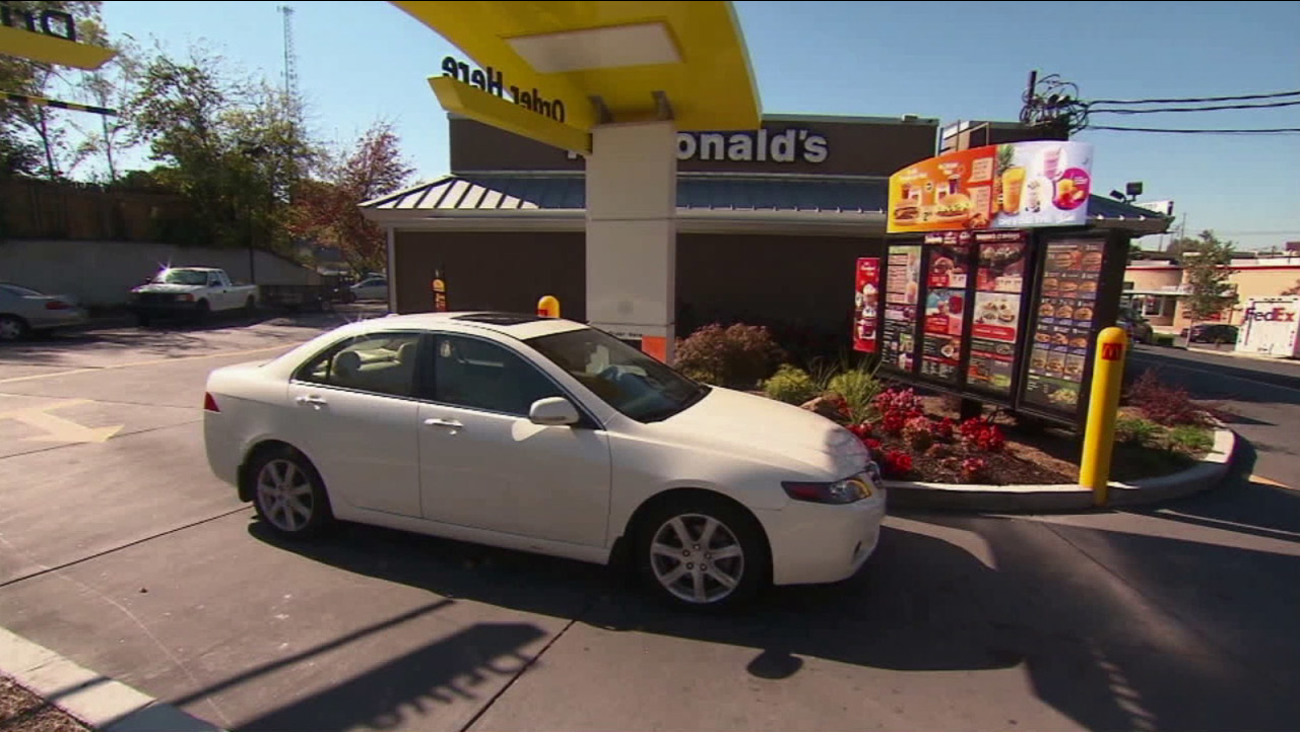 A car enters a drive-thru at a McDonald's in an undated photo.