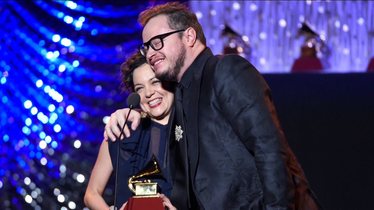 "Natalia Lafourcade, left, and Leonel Garcia accept the award for best alternative song for ""Hasta La Raiz"" at the 16th annual Latin Grammy Awards on Thursday, Nov. 19, 2015."
