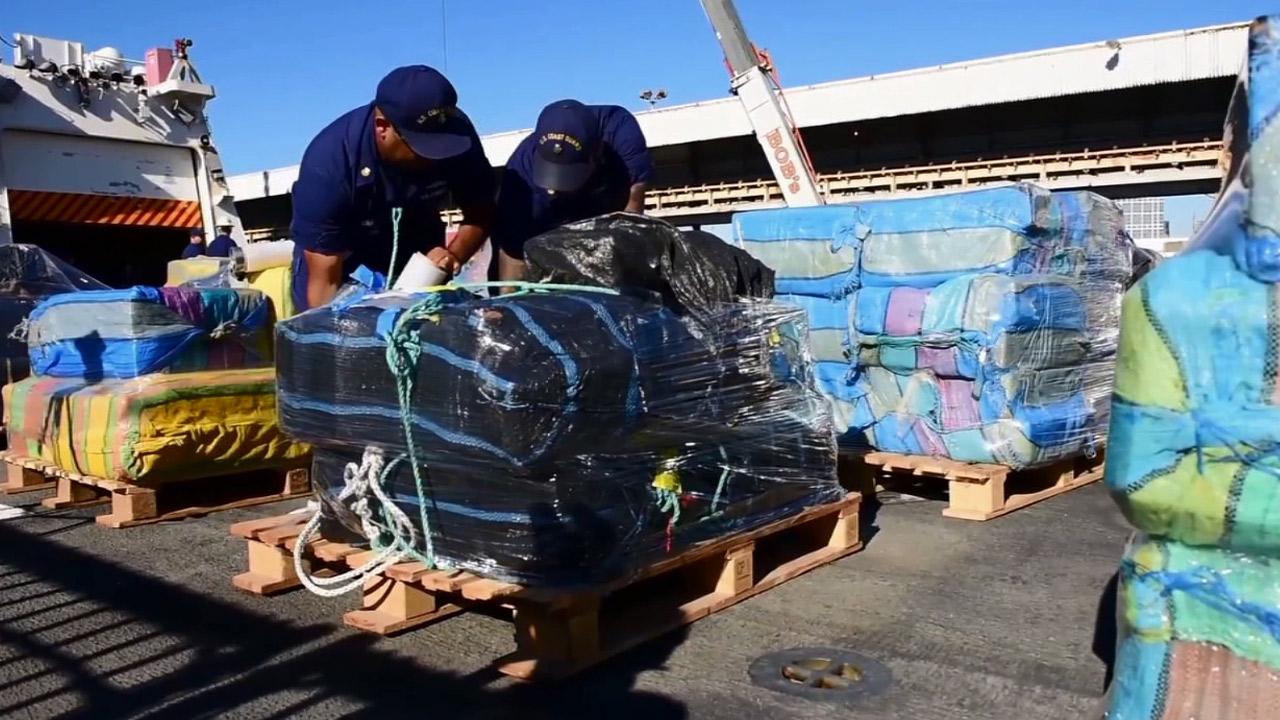 Coast Guards package drugs and ship them off a boat in San Diego on Thursday, Nov. 19, 2015.