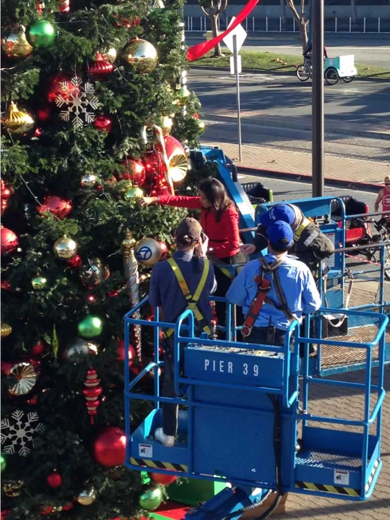 "<div class=""meta image-caption""><div class=""origin-logo origin-image none""><span>none</span></div><span class=""caption-text"">ABC7 News Anchor Ama Daetz places an ornament on the tree at Pier 39 in San Francisco on Saturday, November 21, 2015. (Pier 39)</span></div>"