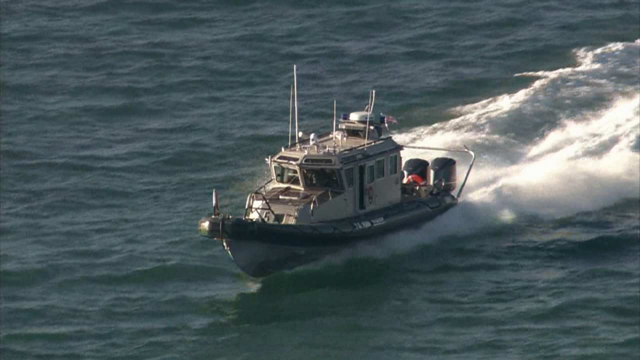 Rescuers search for a missing boater in the ocean waters near Ventura Saturday, Nov. 21, 2015.