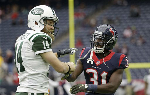"<div class=""meta image-caption""><div class=""origin-logo origin-image none""><span>none</span></div><span class=""caption-text"">New York Jets quarterback Ryan Fitzpatrick (14) and Houston Texans defensive back Charles James (31) visit (AP Photo/ David J. Phillip)</span></div>"