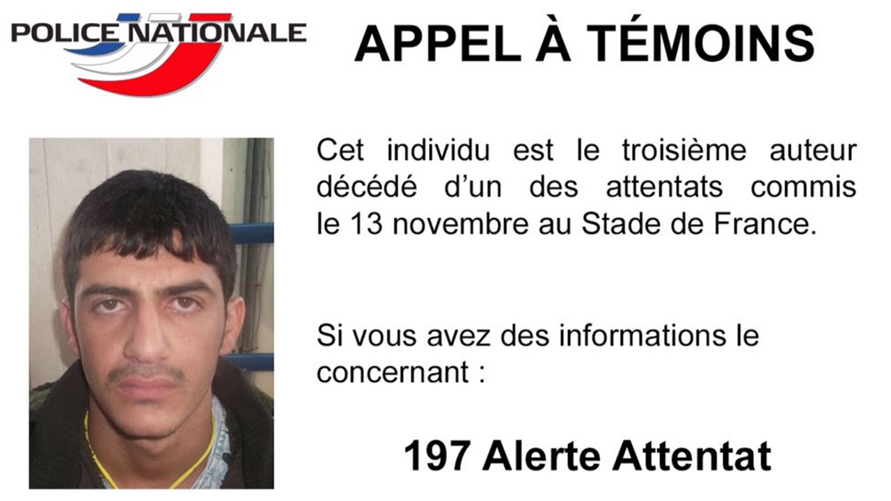 A French poster shows a photo of a third attacker killed during a coordinated attack at a Paris stadium on Friday, Nov. 13, 2015.