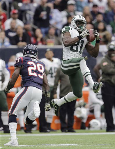 "<div class=""meta image-caption""><div class=""origin-logo origin-image none""><span>none</span></div><span class=""caption-text"">New York Jets wide receiver Quincy Enunwa (81) pulls in a pass as Houston Texans strong safety Andre Hal (29) applies pressure (AP Photo/ Patric Schneider)</span></div>"