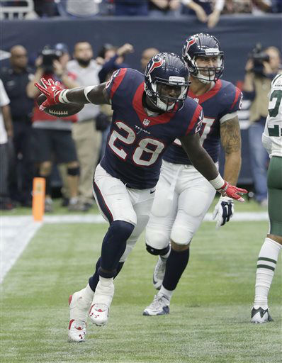 "<div class=""meta image-caption""><div class=""origin-logo origin-image none""><span>none</span></div><span class=""caption-text"">Houston Texans running back Alfred Blue (28) celebrates his touchdown catch from wide receiver Cecil Shorts (AP Photo/ David J. Phillip)</span></div>"
