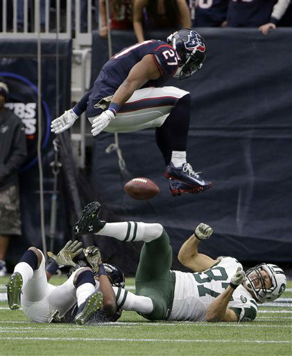 "<div class=""meta image-caption""><div class=""origin-logo origin-image none""><span>none</span></div><span class=""caption-text"">Houston Texans defenders Quintin Demps (27) and A.J. Bouye, left, break up a pass intended for New York Jets wide receiver Eric Decker (AP Photo/ David J. Phillip)</span></div>"
