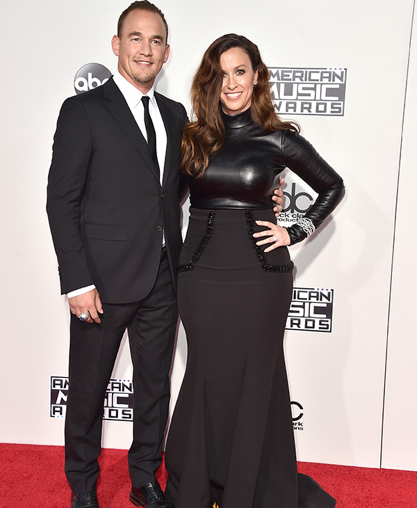 "<div class=""meta image-caption""><div class=""origin-logo origin-image ap""><span>AP</span></div><span class=""caption-text"">Souleye, left, and Alanis Morissette arrive at the American Music Awards at the Microsoft Theater on Sunday, Nov. 22, 2015, in Los Angeles. (Jordan Strauss/Invision/AP)</span></div>"