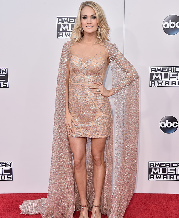 "<div class=""meta image-caption""><div class=""origin-logo origin-image ap""><span>AP</span></div><span class=""caption-text"">Carrie Underwood arrives at the American Music Awards at the Microsoft Theater on Sunday, Nov. 22, 2015, in Los Angeles. (Jordan Strauss/Invision/AP)</span></div>"