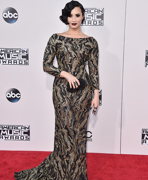 "<div class=""meta image-caption""><div class=""origin-logo origin-image ap""><span>AP</span></div><span class=""caption-text"">Demi Lovato arrives at the American Music Awards at the Microsoft Theater on Sunday, Nov. 22, 2015, in Los Angeles. (Jordan Strauss/Invision/AP)</span></div>"