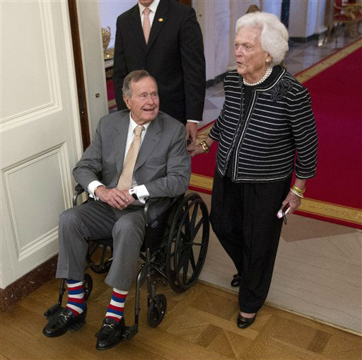 <div class='meta'><div class='origin-logo' data-origin='none'></div><span class='caption-text' data-credit='AP Photo/ Pablo Martinez Monsivais'>In this May 31, 2012 file photo, former President George H.W. Bush, left, and his wife, former first lady Barbara Bush, arrive in the East Room of the White House in Washington.</span></div>