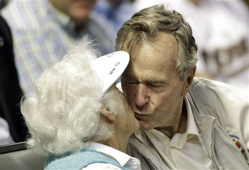 <div class='meta'><div class='origin-logo' data-origin='none'></div><span class='caption-text' data-credit='AP Photo/ David J. Phillip'>Former U.S. President George H.W. Bush kisses his wife, Barbara, after both were shown on the stadium kiss cam video board during a baseball game May 5, 2010, in Houston.</span></div>