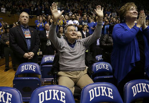 <div class='meta'><div class='origin-logo' data-origin='none'></div><span class='caption-text' data-credit='AP Photo/ Gerry Broome'>Former President George H.W. Bush is introduced during the first half of a college basketball game between Duke and NC State at Cameron Indoor Stadium Jan. 18, 2014.</span></div>