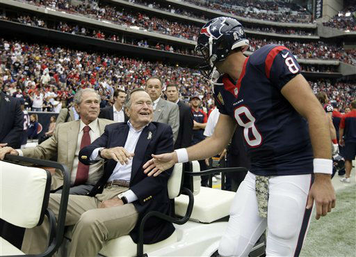 <div class='meta'><div class='origin-logo' data-origin='none'></div><span class='caption-text' data-credit='AP Photo/ Tony Gutierrez'>Matt Schaub shakes hands with former Presidents George H.W. Bush and George W. Bush before an NFL football game against the Oakland Raiders Nov. 17, 2013.</span></div>