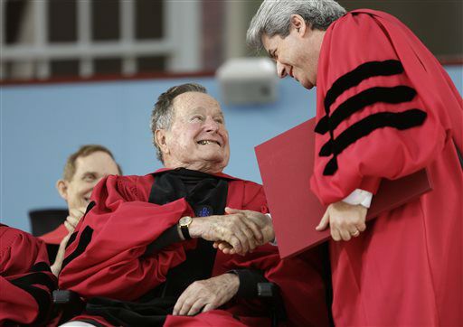 <div class='meta'><div class='origin-logo' data-origin='none'></div><span class='caption-text' data-credit='AP Photo/ Steven Senne'>Former President George H. W. Bush is awarded with an honorary Doctor of Laws degree during Harvard commencement ceremonies May 29, 2014.</span></div>