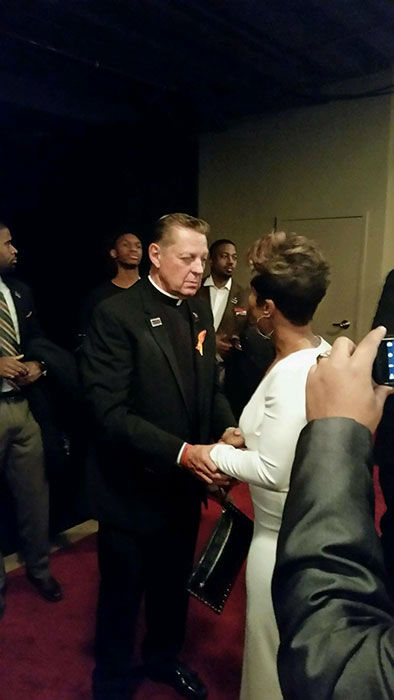 <div class='meta'><div class='origin-logo' data-origin='none'></div><span class='caption-text' data-credit=''>Val Warner talks to Fr. Pfleger at the &#34;Chi-Raq&#34; premiere.</span></div>
