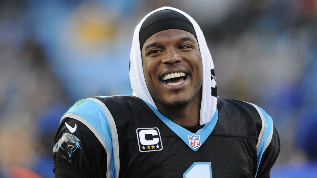 Carolina Panthers' Cam Newton (1) celebrates on the sideline in the second half of an NFL football game against the Washington Redskins in Charlotte, N.C., Sunday, Nov. 22, 2015