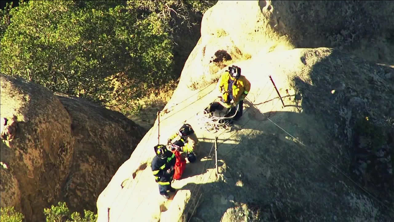 In this image, crews rescue a teenage boy who partially slid down a ledge at Rock City in Mount Diablo State Park on Monday, November 23, 20415.