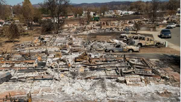 Destroyed homes and vehicles scorched by the Valley fire line Jefferson St. in Middletown, Calif, on Monday, Sept. 21, 2015.