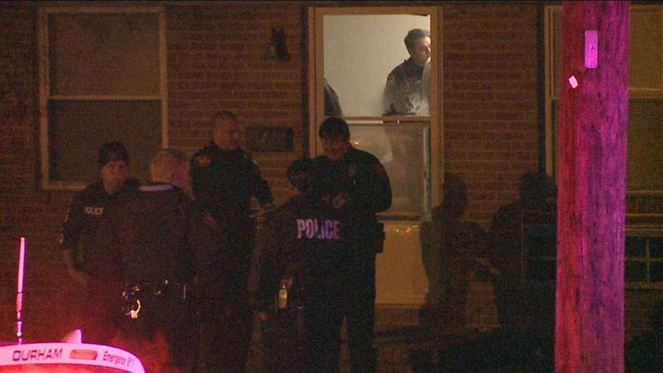 Police investigate at the home.