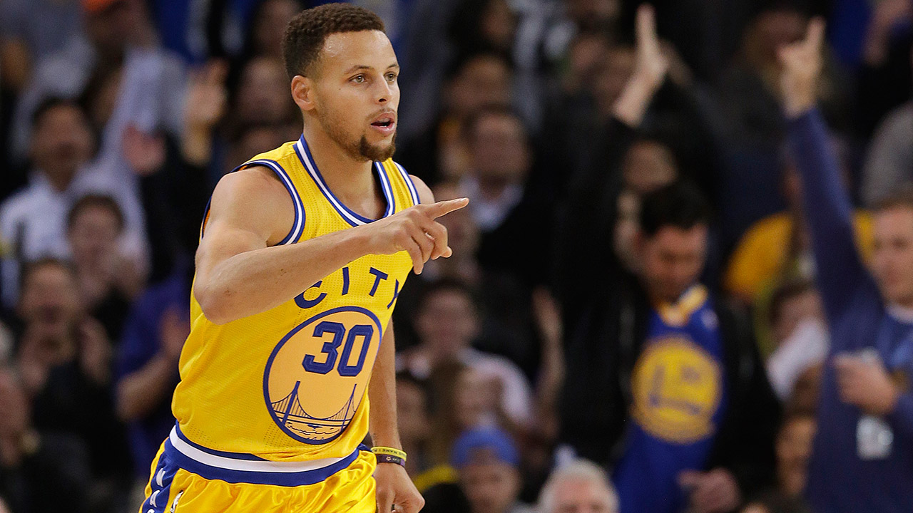 Golden State Warriors guard Stephen Curry (30) reacts after making a 3-point basket on Tuesday, Nov. 24, 2015.