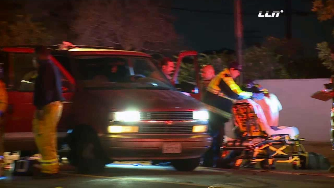 A man being treated after he was shot while inside his minivan in Compton early Monday, Nov. 25, 2015.
