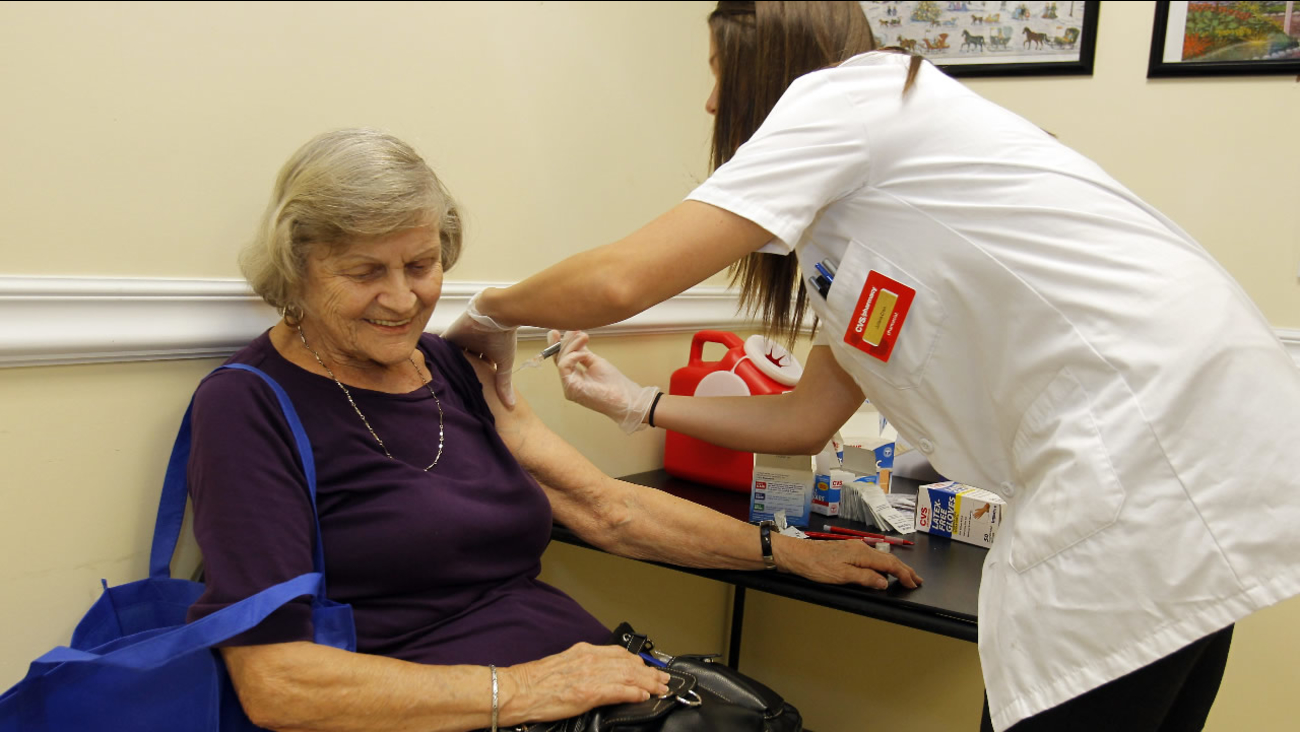 FILE: Julianne Crain gets her flu shot at the Boynton Beach Senior Center in Boynton Beach, Fla. on Thursday, Sept.13,2012.