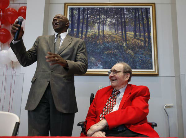 <div class='meta'><div class='origin-logo' data-origin='none'></div><span class='caption-text' data-credit='AP Photo/ Charlie Neibergall'>Former University of Houston basketball coach Guy V. Lewis listens as former player Clyde Drexler speaks during a reception held in his honor.</span></div>