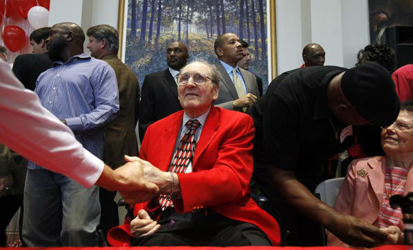 <div class='meta'><div class='origin-logo' data-origin='none'></div><span class='caption-text' data-credit='AP Photo/ Charlie Neibergall'>Former University of Houston basketball coach Guy V. Lewis, center, greets fans following a reception held in his honor, Friday, April 1, 2011, at the school in Houston.</span></div>