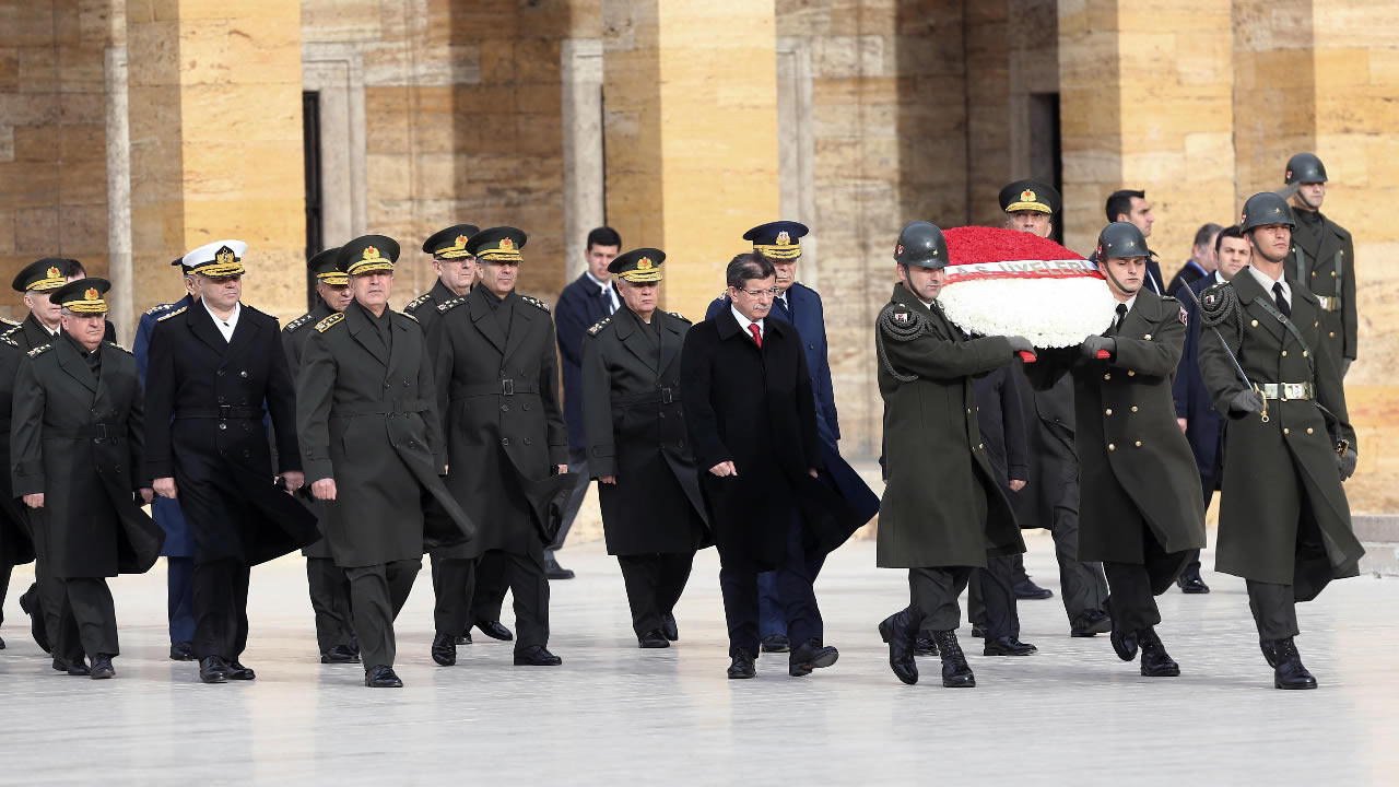 Turkish PM Davutoglu, center-right, and army commanders walk to the mausoleum of Turkey's founder Ataturk before a military meeting in Ankara, Turkey, Thursday, Nov. 26, 2015.