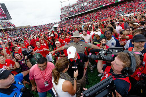 """<div class=""""meta image-caption""""><div class=""""origin-logo origin-image none""""><span>none</span></div><span class=""""caption-text"""">Houston's head coach Tom Herman talking to the media on the field after the win over Navy (AP hoto.)</span></div>"""