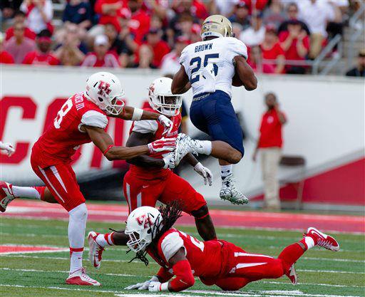 "<div class=""meta image-caption""><div class=""origin-logo origin-image none""><span>none</span></div><span class=""caption-text"">Navy's running back Demond Brown (25) leaps over Houston's safety Trevon Stewart on the field (AP Photo/ Juan DeLeon)</span></div>"