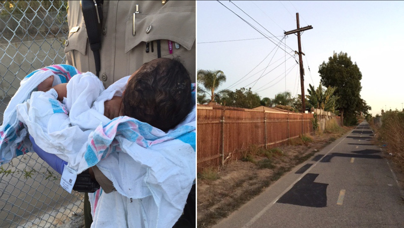 A Los Angeles County sheriff's deputy holds a newborn girl found buried alive near a riverbed in Compton on Friday, Nov. 27, 2015.