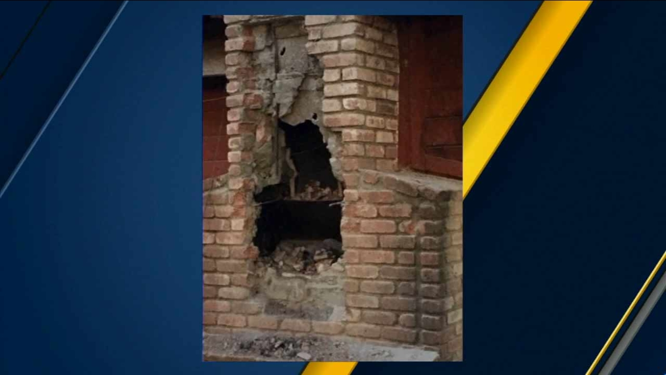 A chimney from a home near Fresno after a suspected burglar, who later died, was rescued from inside.