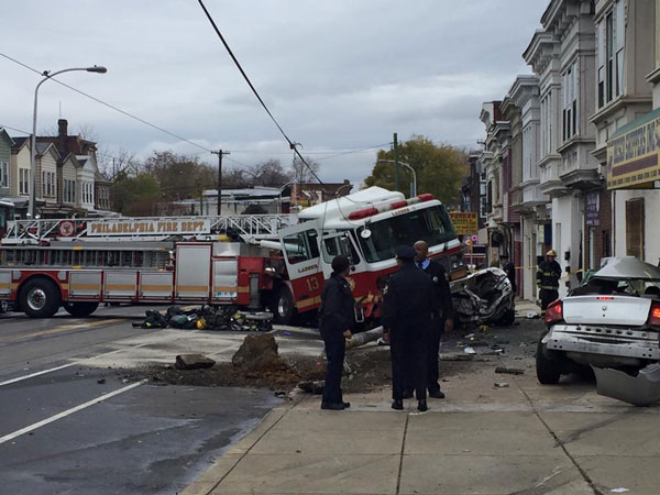 """<div class=""""meta image-caption""""><div class=""""origin-logo origin-image none""""><span>none</span></div><span class=""""caption-text"""">Viewer photo of an accident in West Philadelphia involving a fire truck. (Sharon Shay Laws/ Facebook)</span></div>"""