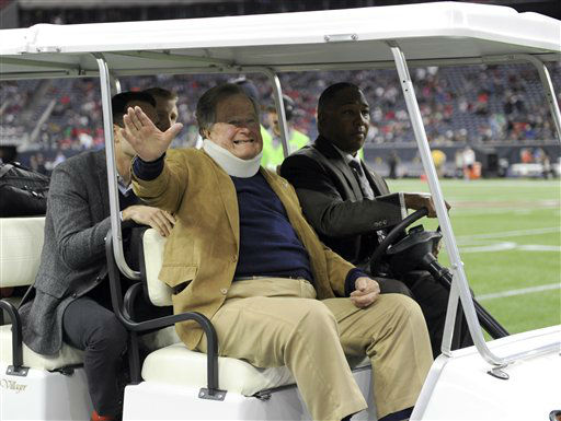 "<div class=""meta image-caption""><div class=""origin-logo origin-image none""><span>none</span></div><span class=""caption-text"">Former President George H.W. Bush waves as he rides in a cart on the field before the game. (AP Photo/ Eric Christian Smith)</span></div>"