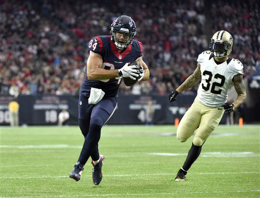 "<div class=""meta image-caption""><div class=""origin-logo origin-image none""><span>none</span></div><span class=""caption-text"">Houston Texans tight end Ryan Griffin (84) runs toward the end zone to score a touchdown (AP Photo/ Eric Christian Smith)</span></div>"