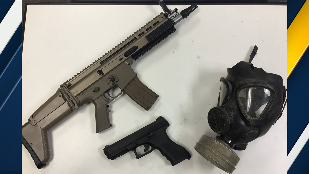 Image of replica guns and gas mask Los Angeles County Sheriff's Department said film students were carrying on Sunday, Nov. 29, 2015.